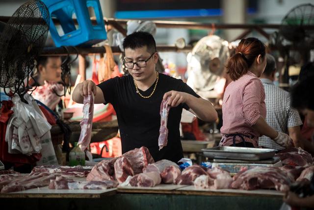 Một quầy thịt lợn tại Thượng Hải, Trung Quốc (Ảnh: Washington Post)