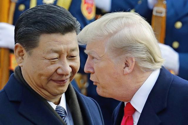 Chủ tịch Tập Cận Bình và Tổng thống Donald Trump trong cuộc gặp tại Bắc Kinh vào tháng 11/2017 (Ảnh: AFP)