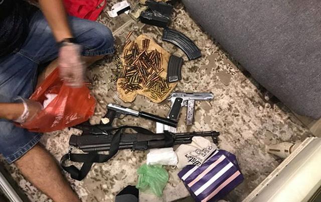 Ngôi nhà của Phạm Bá Sơn và tang vật gồm súng, đạn được cơ quan Công an thu giữ khi khám xét