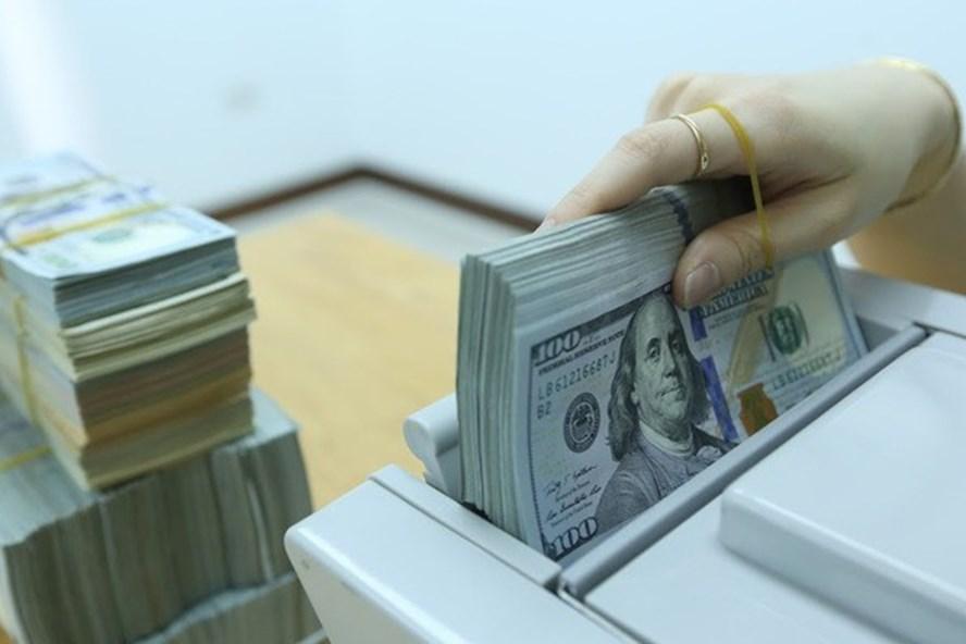 Tâm lý thị trường lạc quan hơn, đồng USD vẫn chịu áp lực mất giá