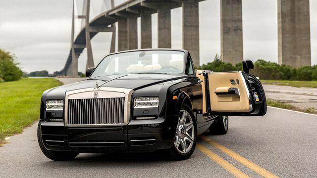 Đại gia mua Rolls Royce, Bugatti Veyron sẽ phải đóng từ 6 đến 8 tỷ đồng phí trước bạ - 1