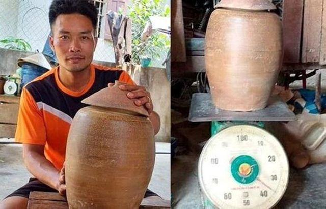 Nghệ An: Đào móng nhà vớ được hũ tiền cổ báu vật - 1