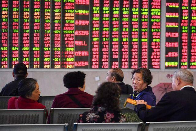 Cổ phiếu châu Á chạm đáy vì chiến trang thương mại Mỹ-Trung leo thang - 1