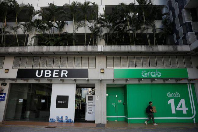 """Vì sao các nước xử phạt còn Việt Nam lại tuyên Grab """"vô tội"""" trong vụ thâu tóm Uber?"""