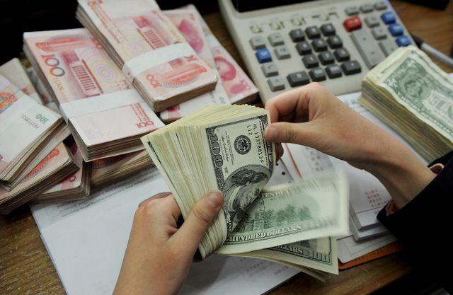 Trung Quốc liên tục phá giá nhân dân tệ: Giới đầu tư Việt Nam theo sát diễn biến - 1