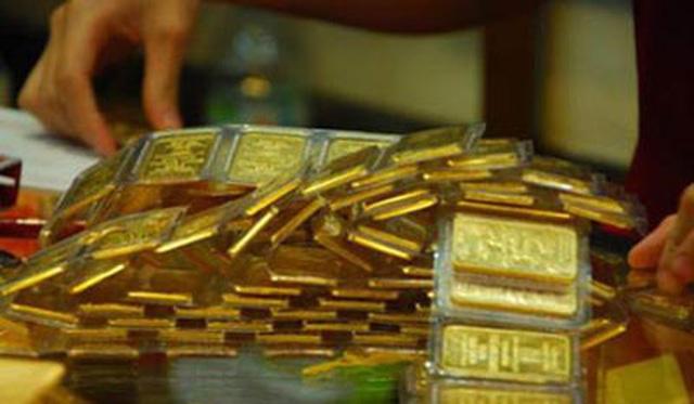 Giá vàng bất ngờ tăng mạnh trước dự báo đi xuống - 1