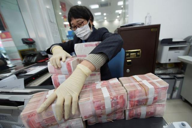 Trung Quốc tiêu hủy tiền từ bệnh viện, chợ để ngăn virus corona - 1
