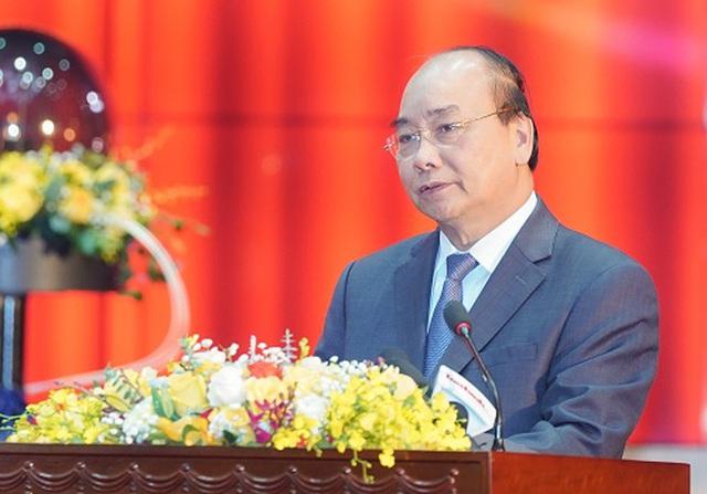 Thủ tướng: Sớm miễn, giãn, giảm thuế cho DN khó khăn bởi dịch Covid-19 - 1