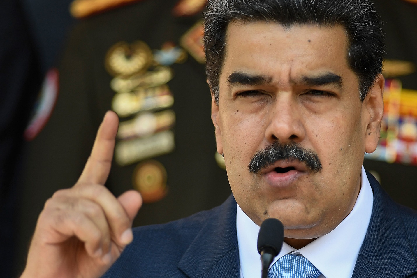 Description: Nicolás Maduro threatens 'racist cowboy' Trump in face of charges