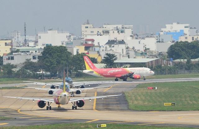 Sửa đường băng Nội Bài, Tân Sơn Nhất, khách đi máy bay phải đến sớm 2 tiếng - 1