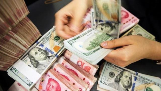 Tiền Việt đang mạnh hơn so với tiền Trung Quốc - 1