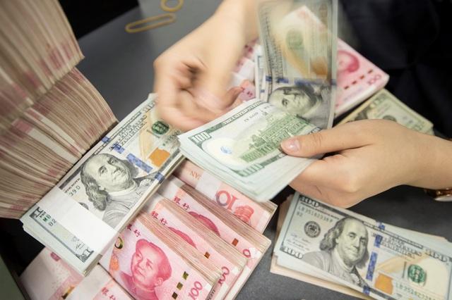 Đồng Nhân dân tệ không thể cạnh tranh với đồng USD - 1