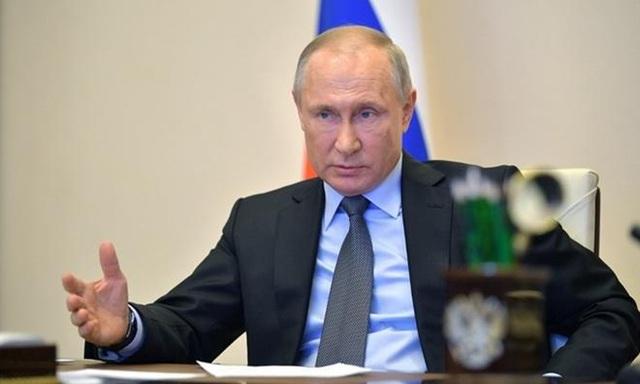 Ông Putin lần đầu lên tiếng về cáo buộc ông Biden nhận tiền của Nga - 1