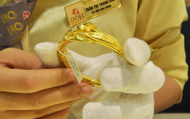 Đón tin tốt, giá vàng sụt giảm - 1