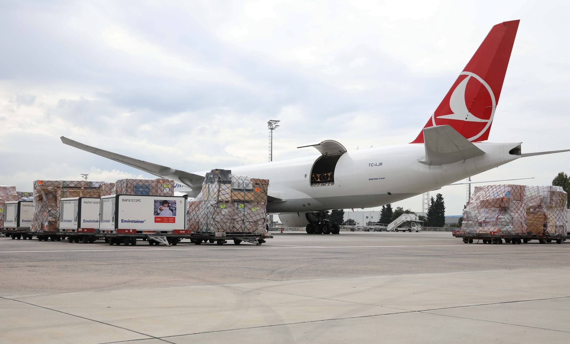 Active temperature control containers carrying China's Sinovac experimental COVID-19 vaccines are loaded onto a Turkish Cargo plane at Ataturk Airport in Istanbul before departing to Brazil on Nov. 18. | TURKISH AIRLINES / VIA REUTERS