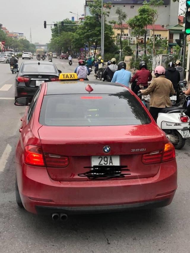 Xe sang BMW gắn mào taxi trên đường phố Hà Nội khiến dân mạng xôn xao - 2