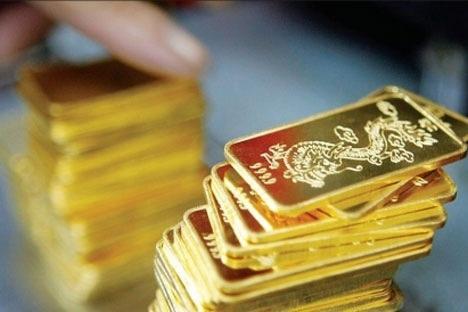 Giá vàng tiếp tục giảm, USD phục hồi