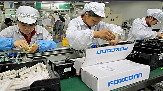 Hàng chục nghìn công nhân lắp ráp iPhone phải nghỉ việc vì lũ lụt lịch sử - 1