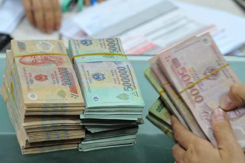 Nâng lương tối thiểu vùng I lên 2,7 triệu đồng từ 1/1/2014