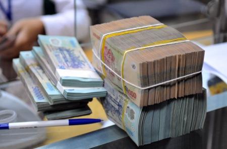 Năm 2014, tiếp tục áp trần lãi suất tiền gửi VND
