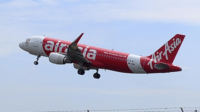 10 thành viên trong một gia đình thoát nạn vì lỡ chuyến bay QZ8501