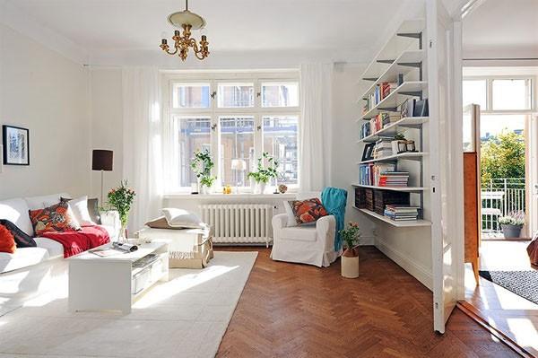 Đặt thêm cây cảnh trong phòng sẽ giúp nới rộng không gian phòng khách