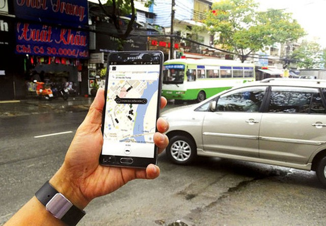 Các bộ, ngành vẫn loay hoay tìm giải pháp quản lý Uber, Grab (Ảnh minh họa)