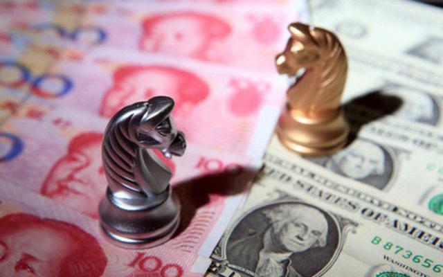 Chuyên gia cho rằng, tỷ giá trong nước sẽ chịu áp lực từ cuộc chiến thương mại Mỹ - Trung.